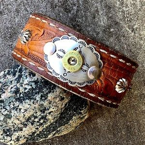 Leather cuff,, sterling concho